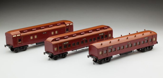 (l-r) Victorian Railways CW guard's van, second class and first class passenger cars, made from wood with lead composition and diecast wheels by John May and Alan Budge