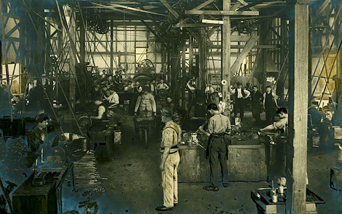 A photo of men at work inside the Sunshine Harvester Works.