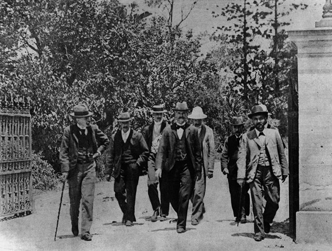 A group of men wearing suits and hats.