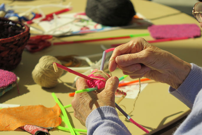 A close-up of a pair of hands of a person undertaking a craft activity.