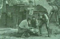 Black and white photo of three men huddled around gold pan