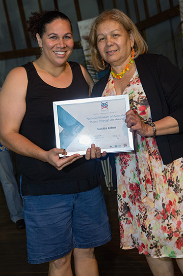 Two women with a certificate award