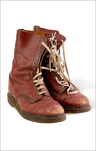 A pair of maroon leather Doc Martens boots