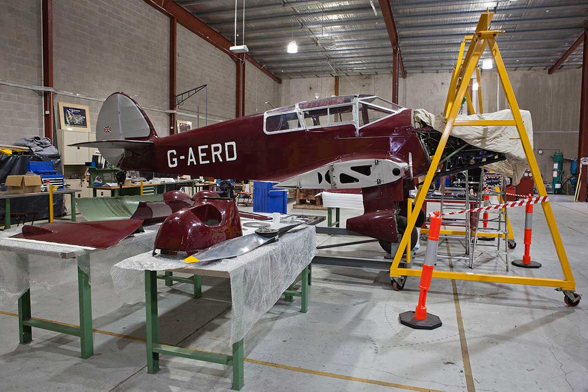 The Gull underneath a gantry in the workshop, with wings, propeller and engine cowling removed.  - click to view larger image