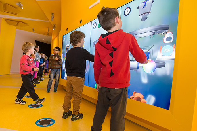 Children interacting with touch screens at the Design Stations in Kspace. - click to view larger image