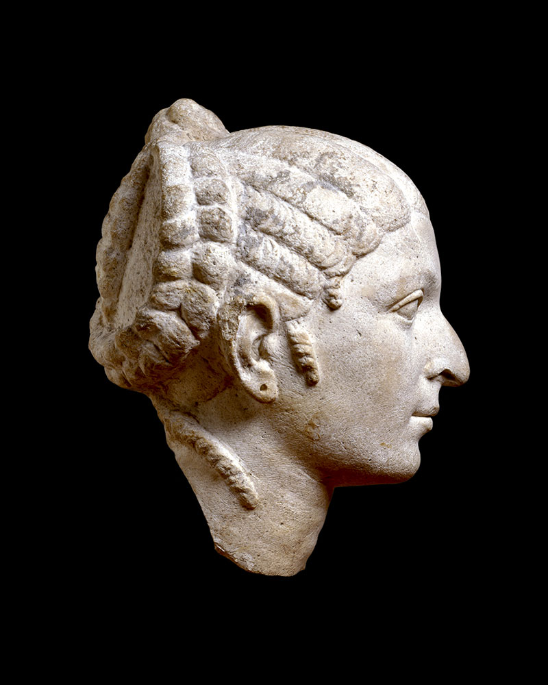 Side view of a sculpted head - click to view larger image