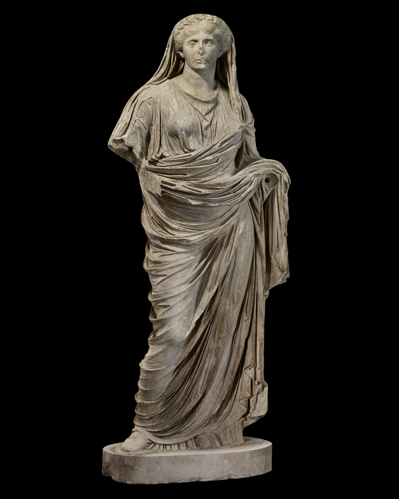 A marble statue of a woman. - click to view larger image