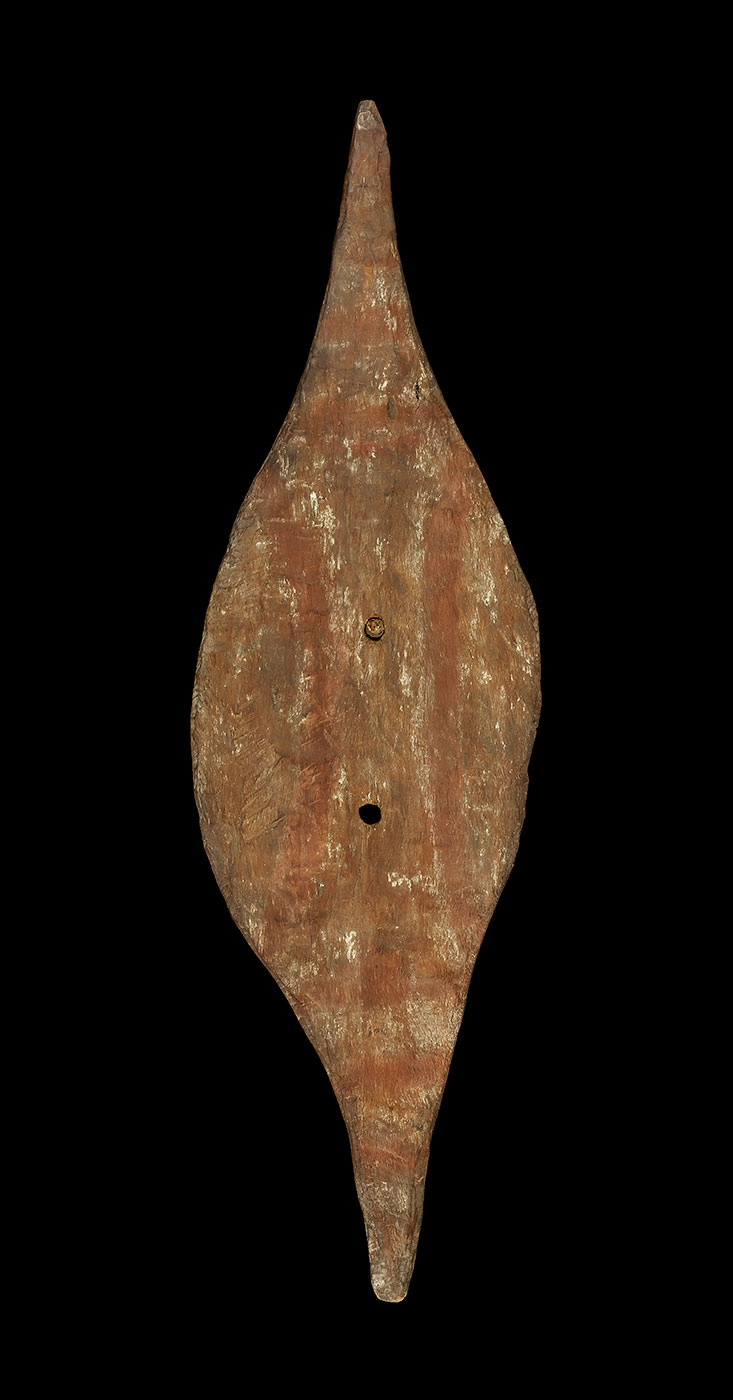 Shield, made of wood, decorated with red and white pigment. - click to view larger image