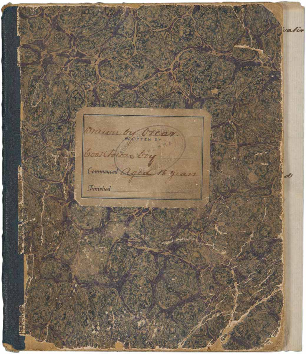Marbled front cover of a sketchbook with handwriting that reads, 'Drawn by Oscar' - click to view larger image