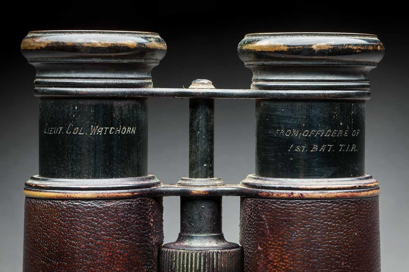 Detail image showing top part of binoculars engraved 'Lieut. Col. Watchorn'