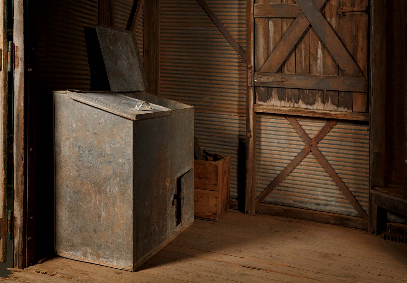 A cook's galley in the form of a metal-clad, timber and iron-framed box raised on wagon wheels. This view is of the vermin proof tin compartments used to store flour and sugar. - click to view larger image