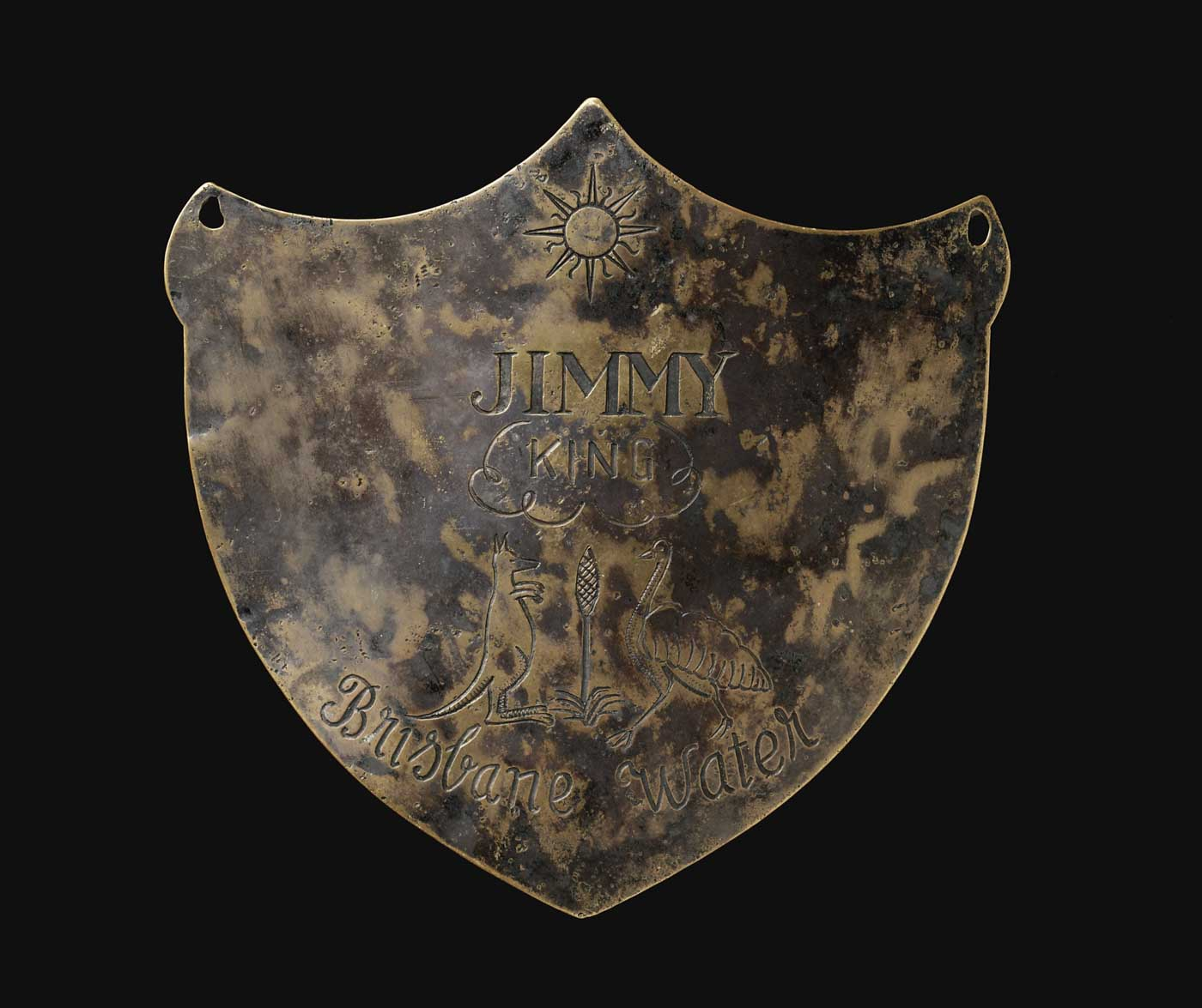Engraved breastplate with an image of a sun at top and a central kangaroo and emu. - click to view larger image