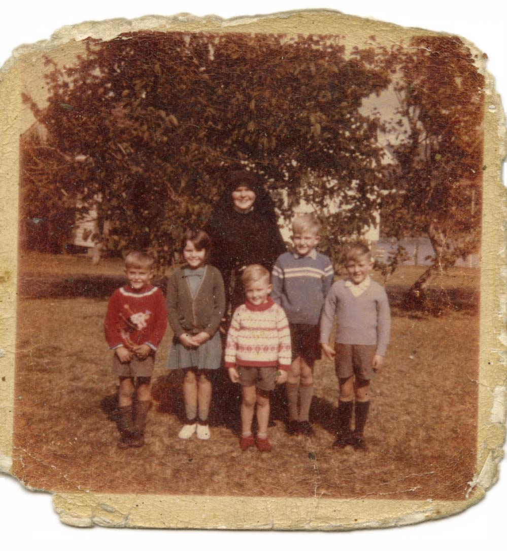 Photograph of Mary Brownlee and her siblings, with Sister Judith Kelly, at St Joseph's Home, Kincumber, New South Wales. The photograph was taken by Mary's father, who used to visit every Sunday, 1969. - click to view larger image