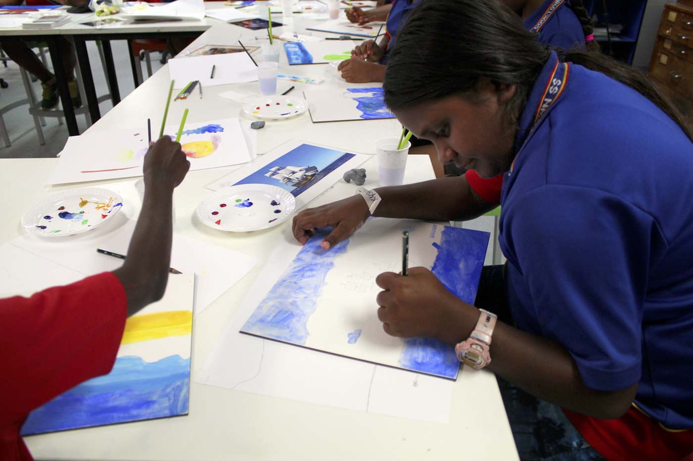 Primary school students attend a painting class. - click to view larger image
