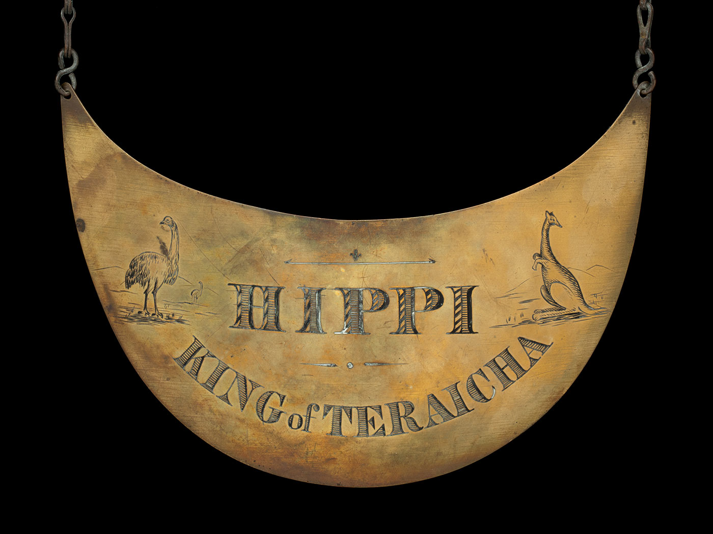 Engraved breastplate that reads 'Hippi, King of King of Teraicha' and includes images  of an emu and kangaroo. - click to view larger image