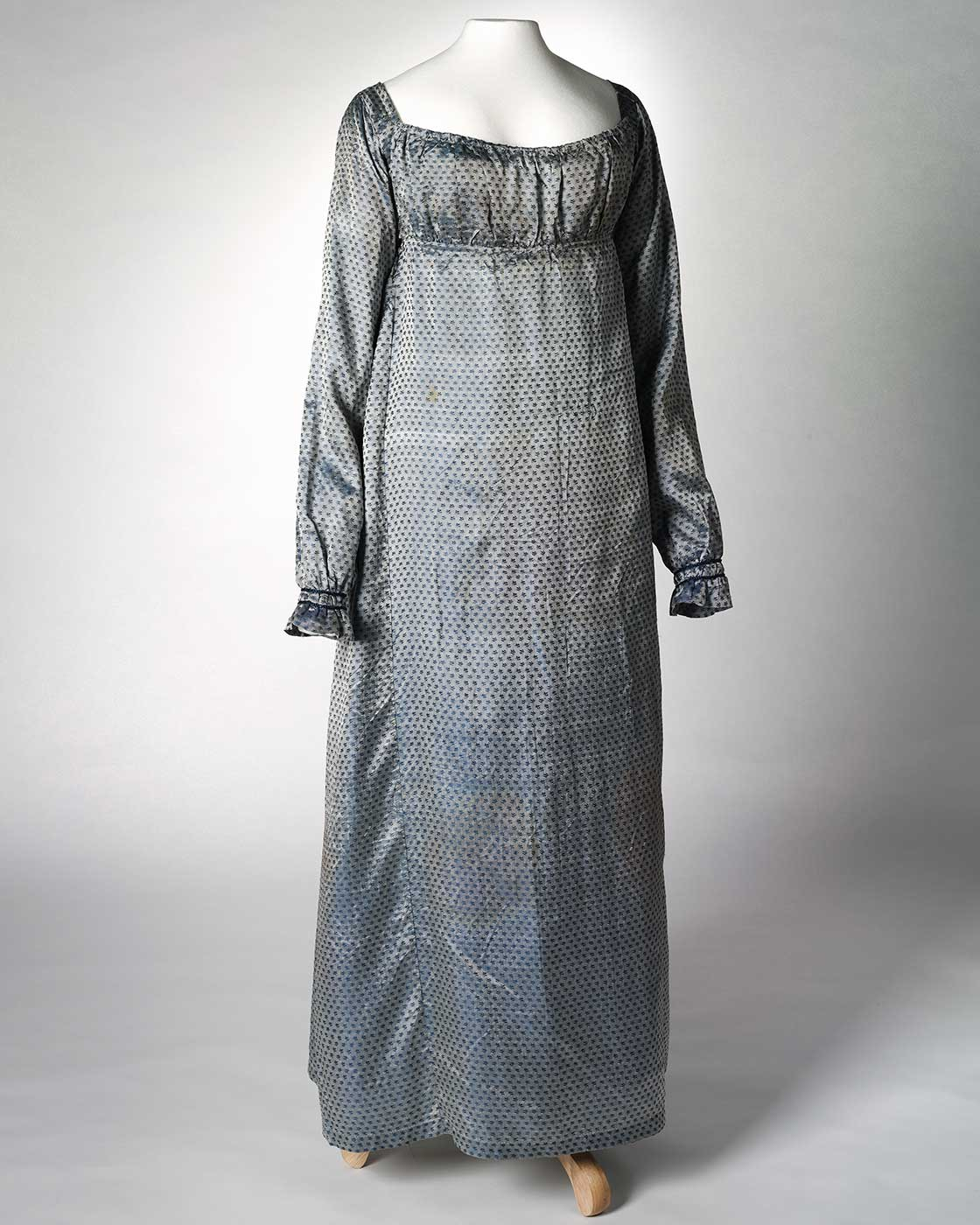 Front view of a blue silk full length empire-line dress. - click to view larger image