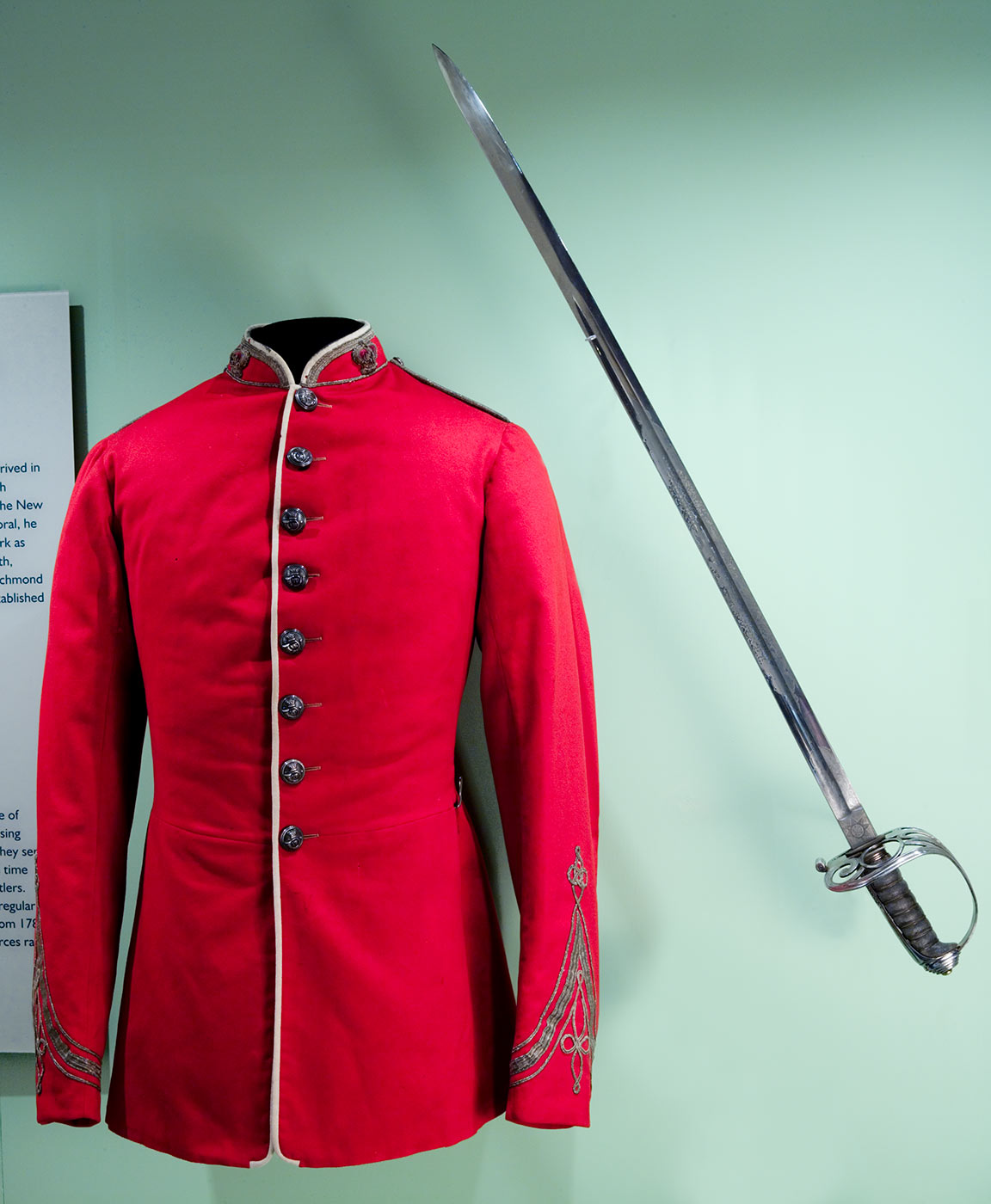 Red Volunteer Rifles military tunic with gold buttons down the front and dress sword. - click to view larger image