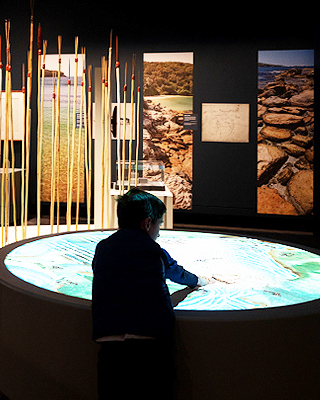A young visitor engaging in an exhibition multimedia experience.
