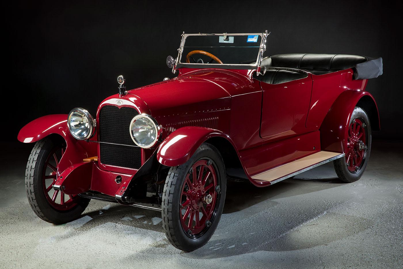 Antique red car being displayed. - click to view larger image