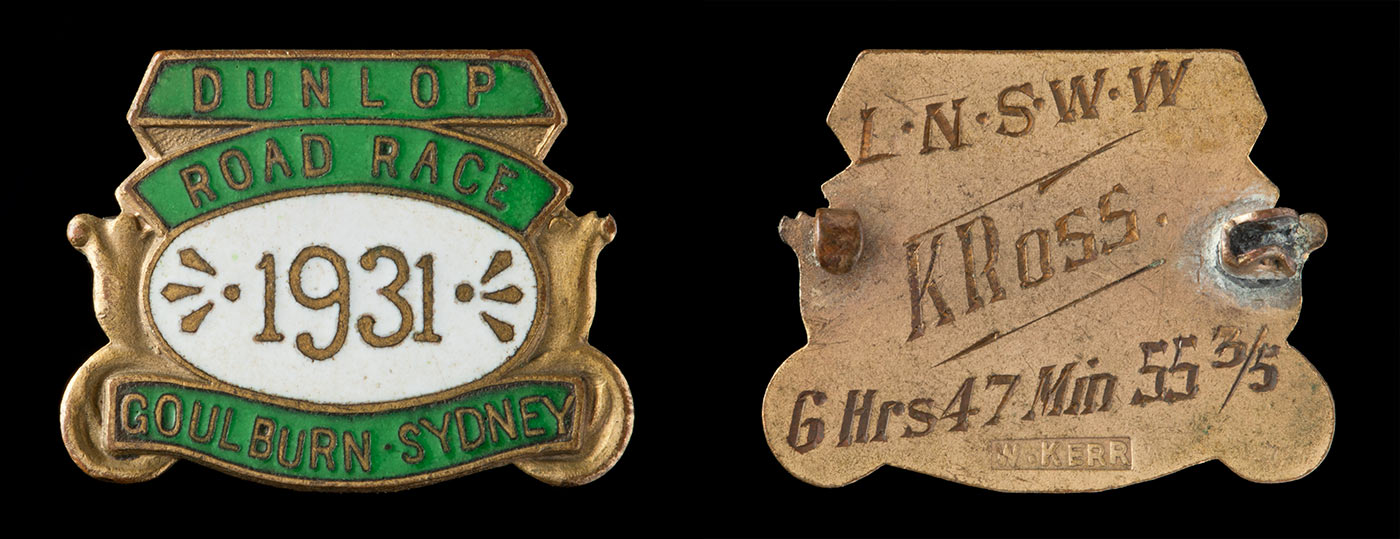 Front and back of a green enamelled metal medal in a sheild design. Text: front - DUNLOP / ROAD RACE / 1931 /GOULBURN . SYDNEY; back - L.N.S.W.W / K ROSS. / 6 Hrs 47 Min 55 3/5. - click to view larger image