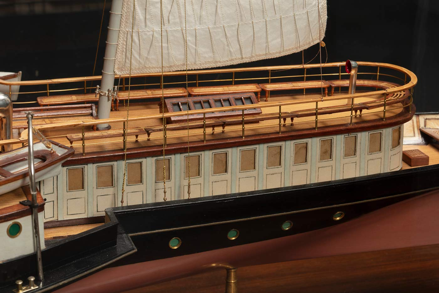 Detail of a model of a ship featuring the rear upper area of the deck. - click to view larger image