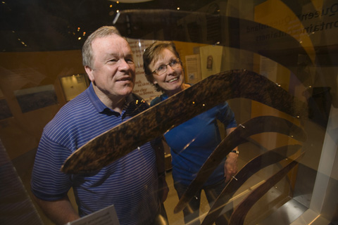 Visitors viewing boomerangs in the New South Wales display.