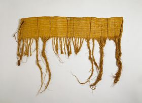 Hand-woven cloak made of flax.