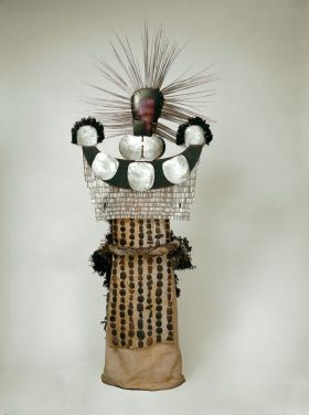 A mourning dress formed of cock's feathers fastened to a kind of netting made of cordage with sticks. Head-piece made of two large mother-of-pearl shells.