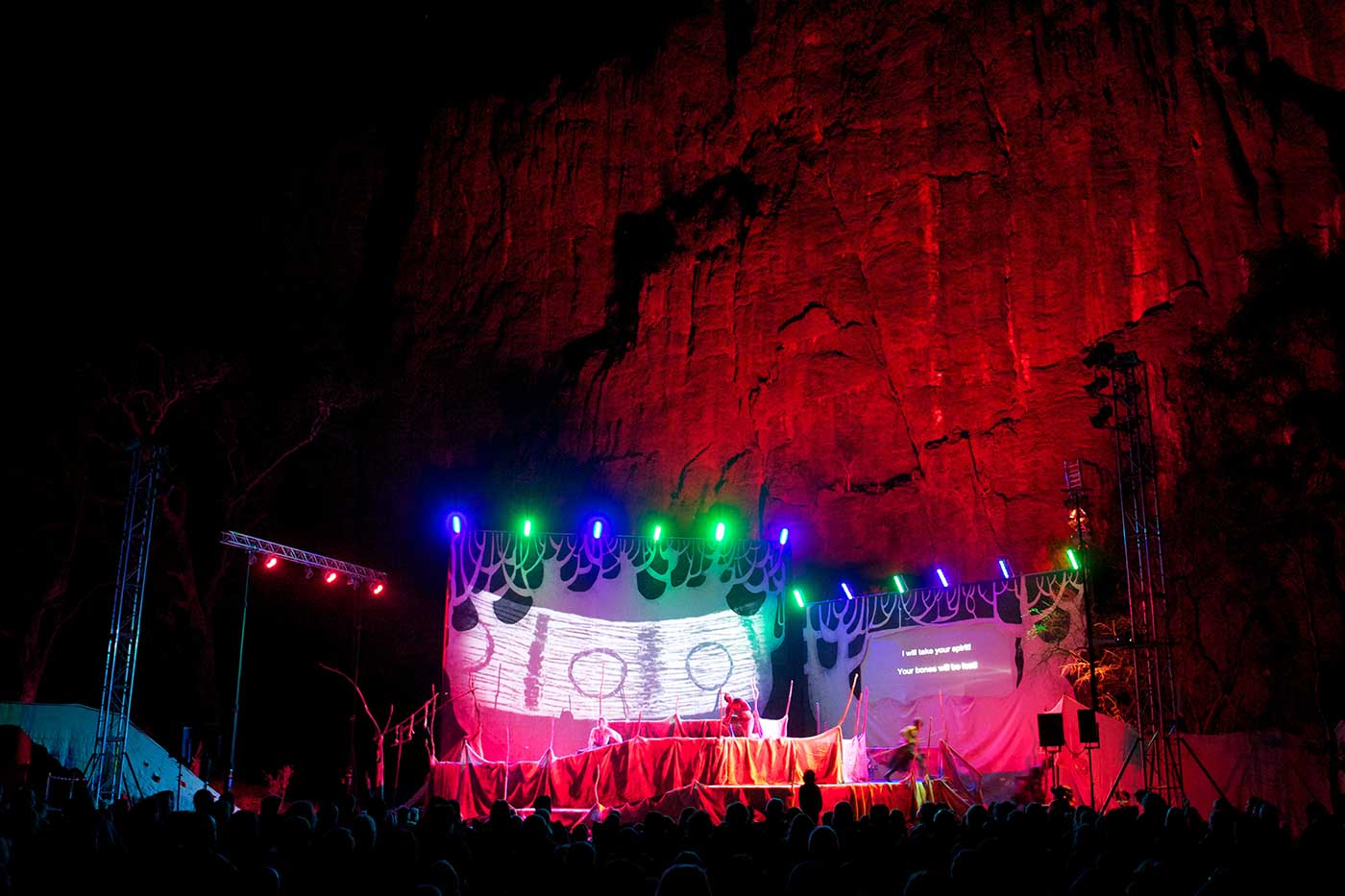 A stage with lights, set in a rocky landscape. - click to view larger image