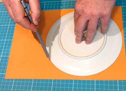 Hands folding paper