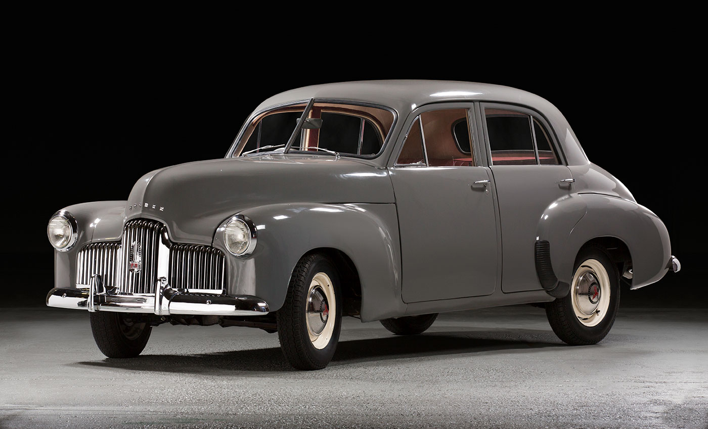 Antique grey car being displayed. - click to view larger image