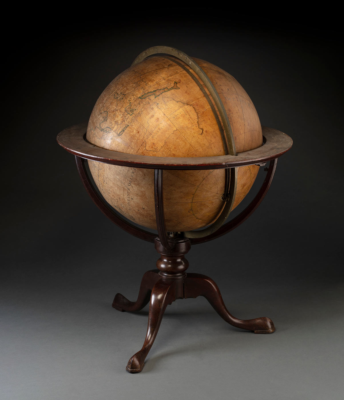 Terrestrial globe showing details of Cooka019s first voyage, set in the original English mahogany tripod stand. - click to view larger image