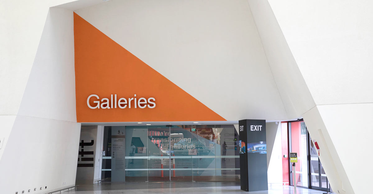 Glass sliding door entrance to a Galleries section.
