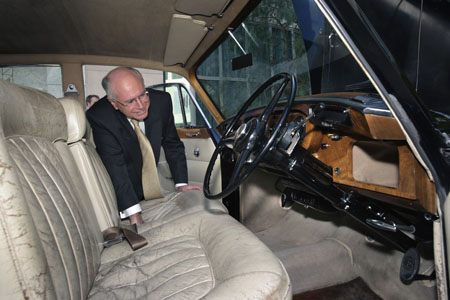 John Howard peers into the front of the Bentley to inspect its seats, steering wheel and dash.