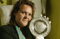 Detail of Evonne Goolagong Cawley holding her 1980 women's Wimbledon trophy