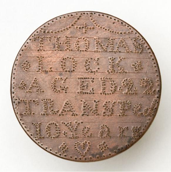 Token engraved with the words 'Thomas Lock age 22'.