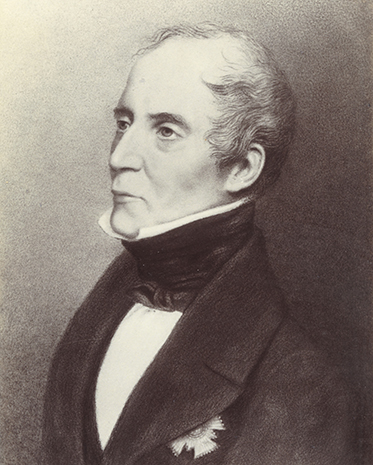 three-quarters portrait of a middle-aged man dressed in frock coat and cravat. A decoration of some kind on his left breast is concealed by the large lapels
