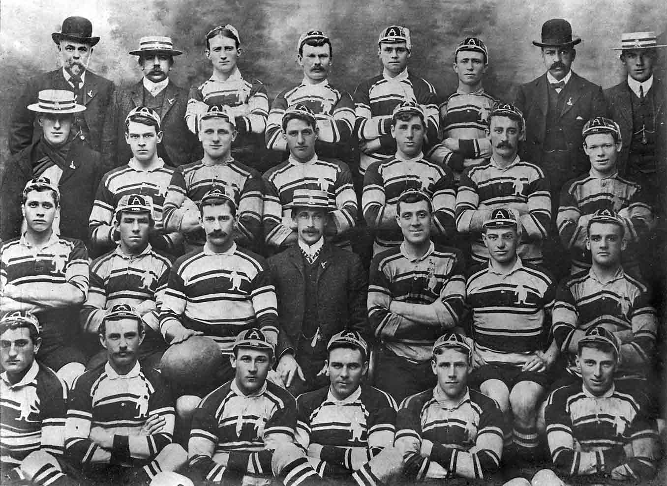 Group shot of Australian rugby union team, in four rows.