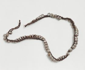 Ornamental band made of small Trochi Shells, and plaited together from sinew cord.