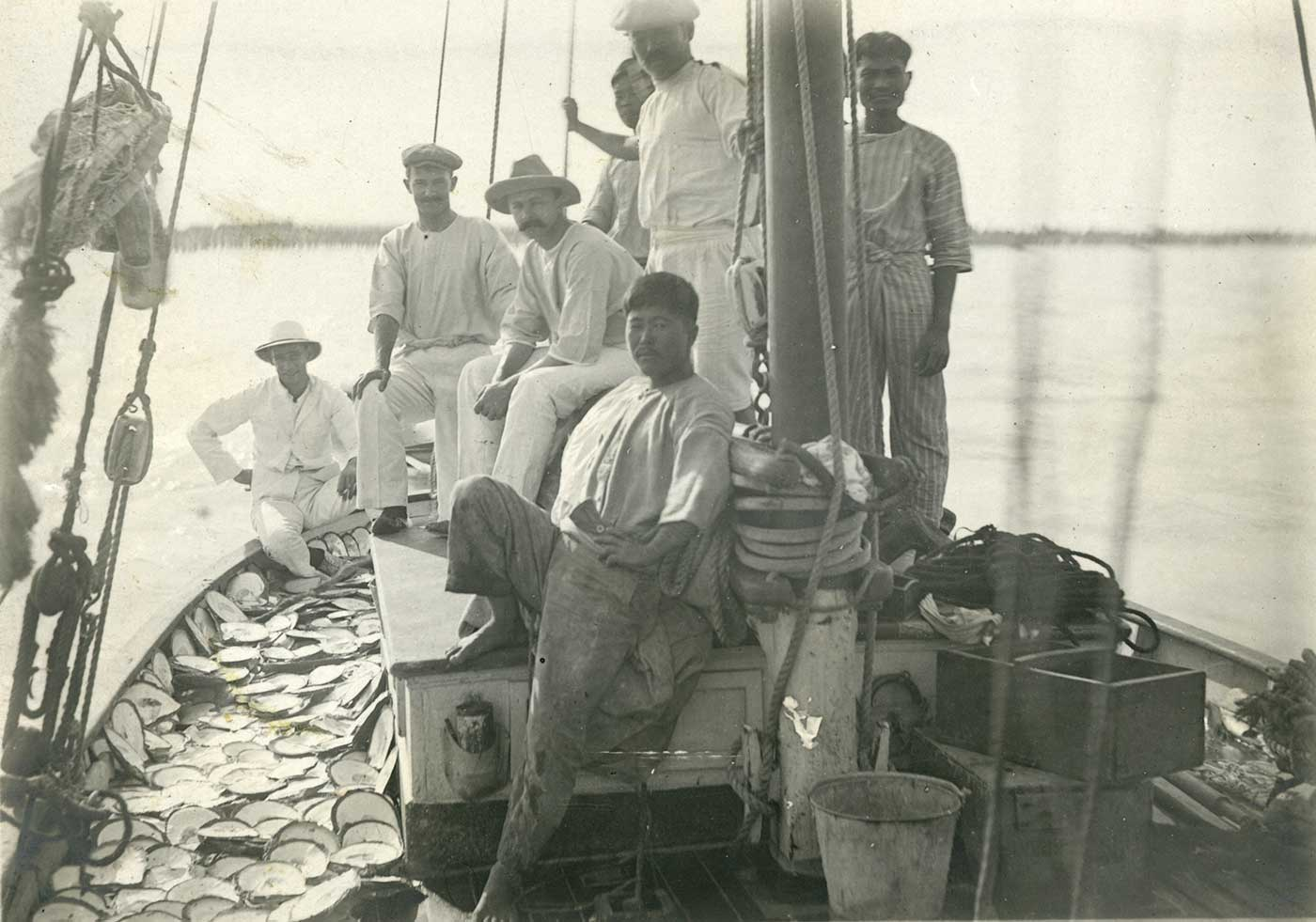 Men aboard a pearling lugger - click to view larger image