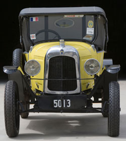 Front view of yellow and black Citroen car.