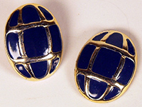 A pair of navy and gold earrings.