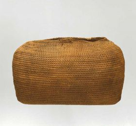 Basket made of sticks from the coconut palm leaf, wrapped up with coconut fibre strings, and connected to one other with the same material.