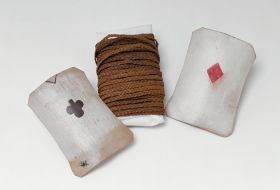 Cord made of coconut fibres and wound round old English playing cards.
