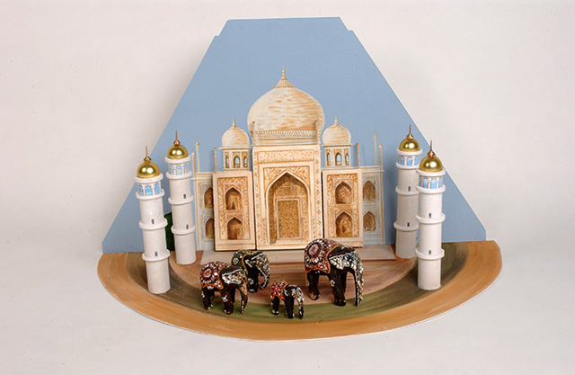 A painted carboard and polystyrene diorama of the Taj Mahal, which includes four model elephants.