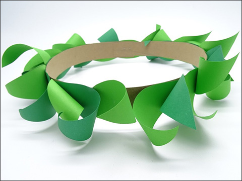 An adorned wreath with green paper leaves