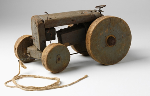 Toy wooden tractor constructed from timber and wire with two larges ...
