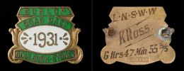 Front and back of a green enamelled metal medal in a sheild design