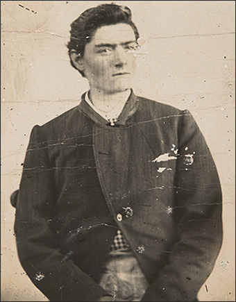 Photo of a young man taken from waist up.