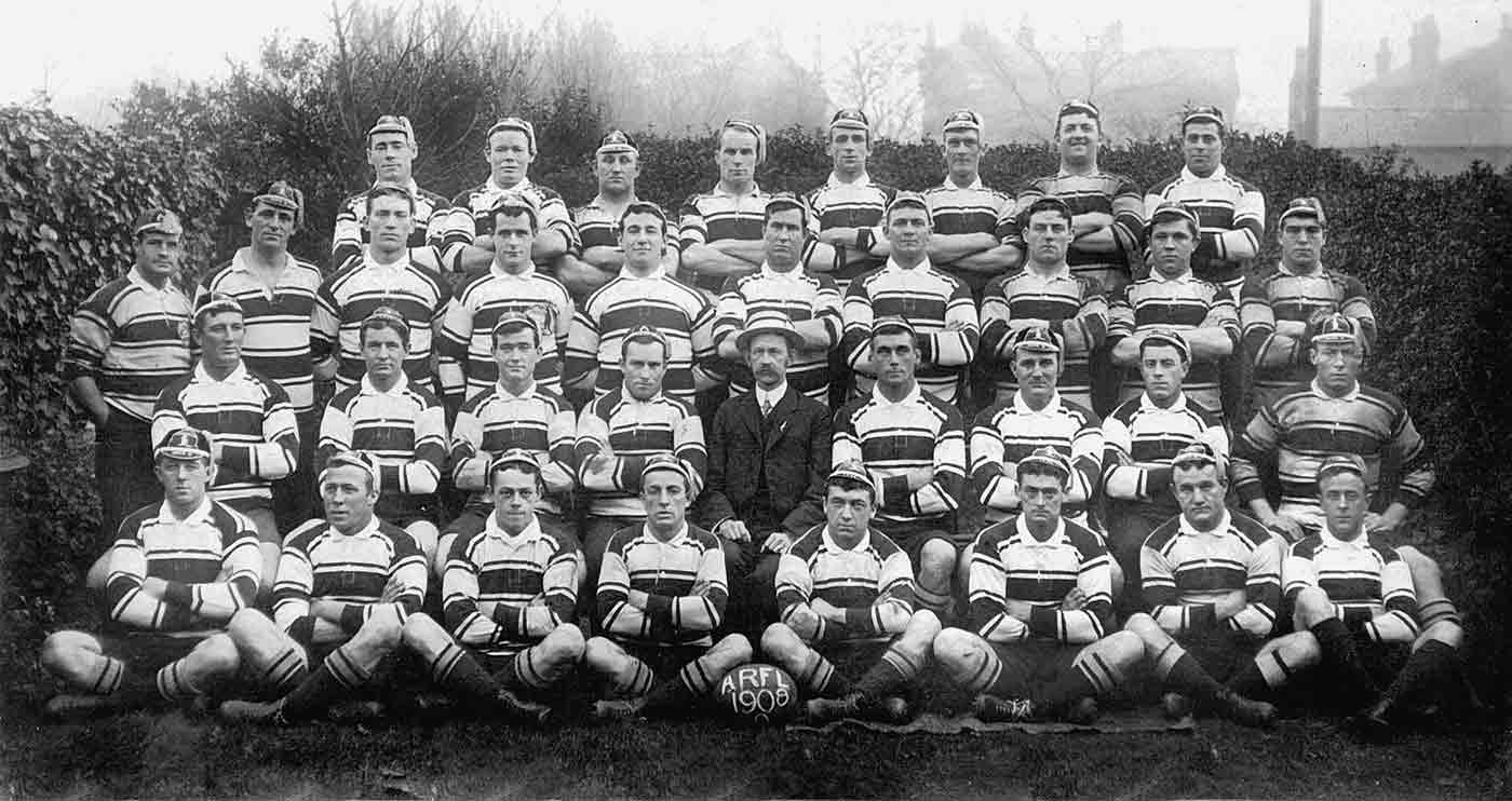 Portrait of a football team, with four rows of men wearing striped jerseys. A ball, front centre, reads 'ARFL 1908'.